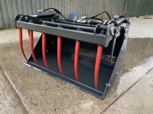 Skid steer bucket grab designed to fit all skid steer loaders, seen with bobcat brackets fitted