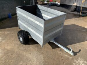 A British Made Quad or ATV trailer desinged to the safe transport of sheep, lambs and livestock on and off road.