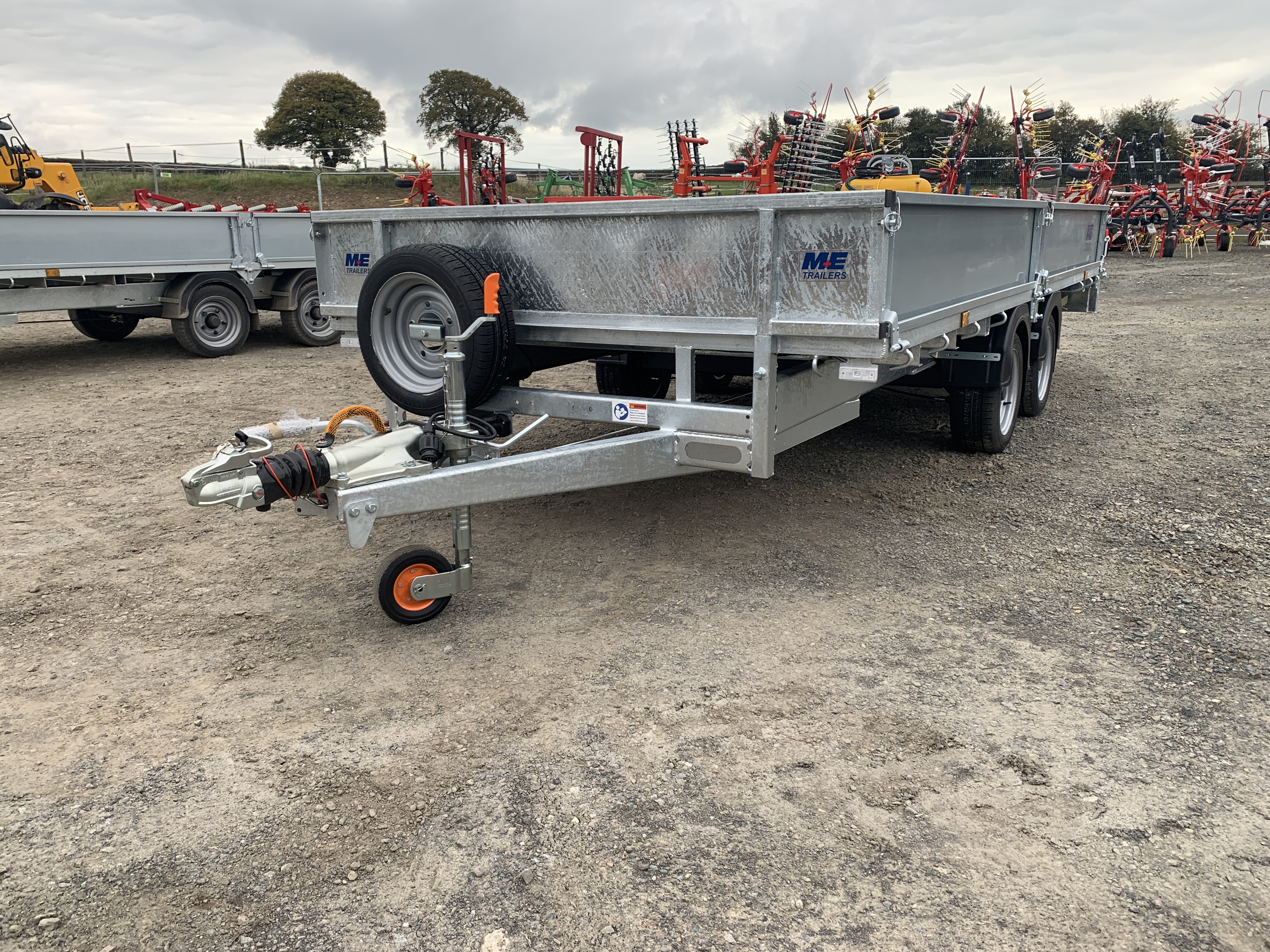 An unloaded Meredith and Eyre flat bed car trailer with drop down sides, led lights and aluminium ramps.