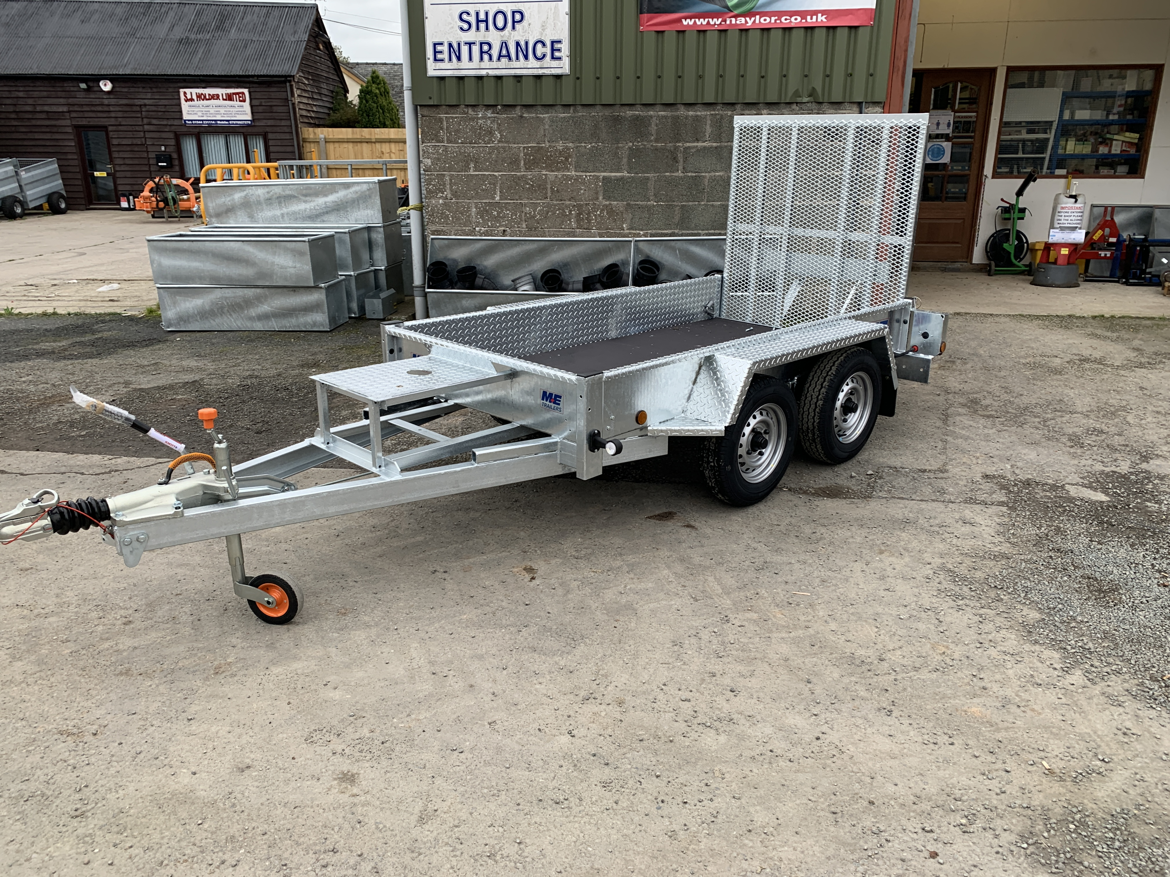 Meredith and Eyre plant and digger trailer with drop down ramp, led lights